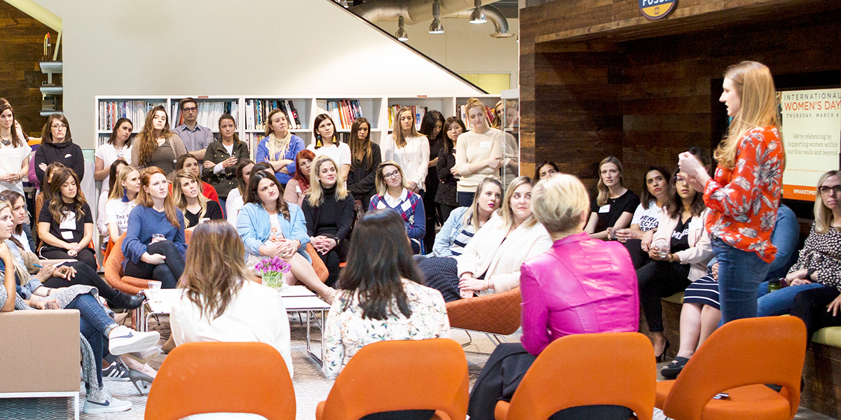 A Panelist of women in leadership take turns sharing a story at Fossil Group's Womens Day Happy Hour