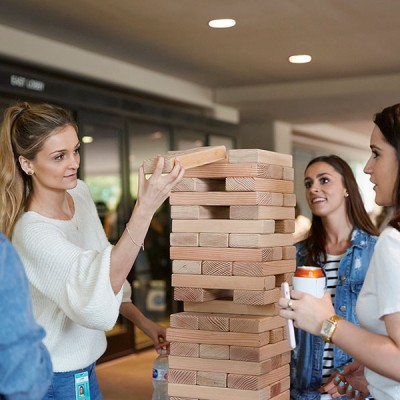 Fossil Group employees play giant Jenga at annual spring fest